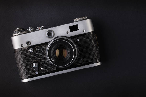 retro camera on black background - webcam stock photos and pictures