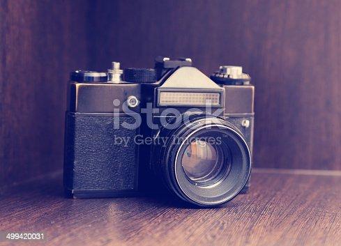 609706398 istock photo retro camera on the shelf 499420031