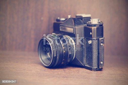 609706398 istock photo retro camera on the shelf 503084347