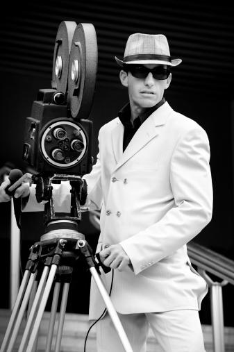 Monochrome retro portrait of a camera operator. Paparazzi.