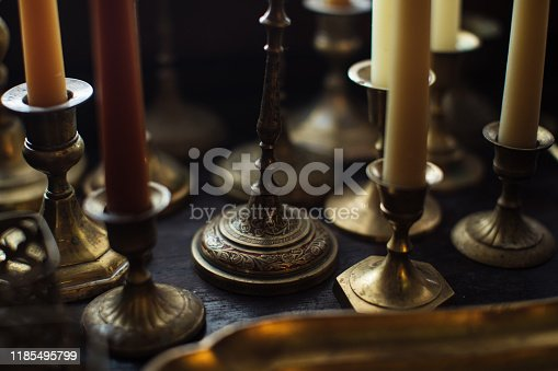 istock Retro Candelabra with Candles on wooden surface 1185495799