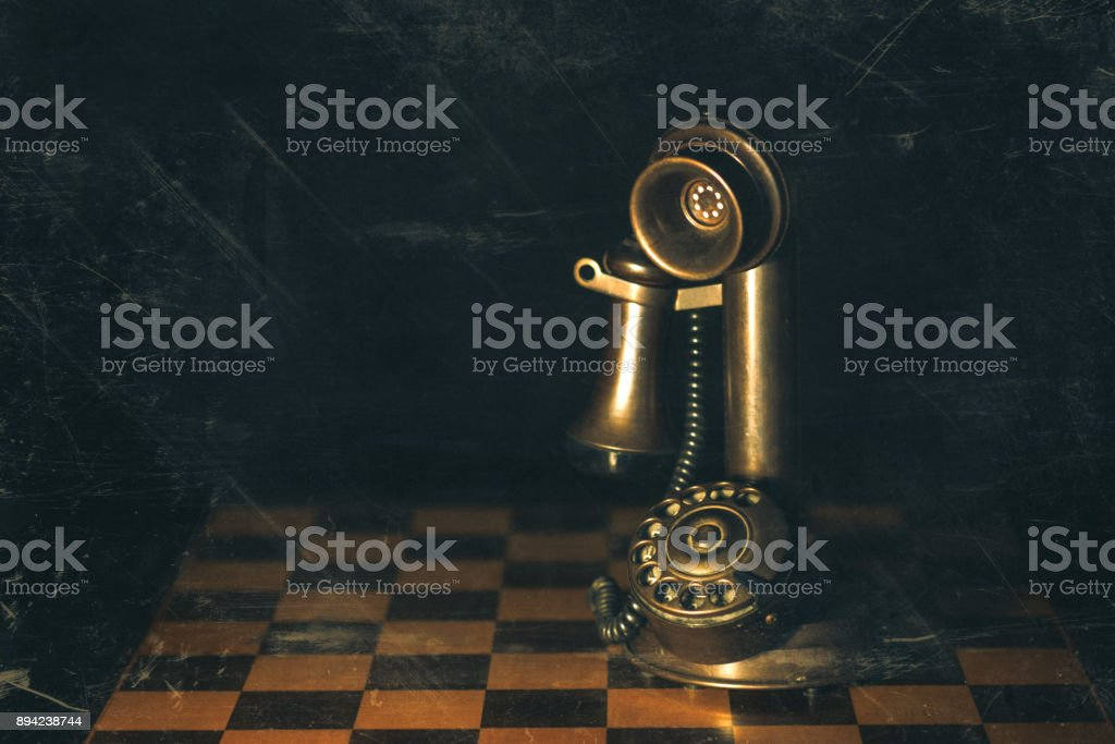 Retro candlestick telephone  set on a chess game photography with created artifacts stock photo
