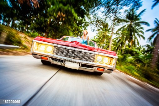 Romantic couple driving car on vacation