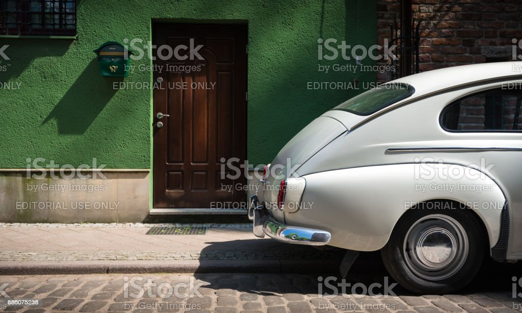 Retro car parked in street of Gdansk old town, Poland stock photo
