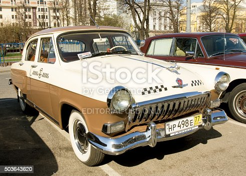 Moscow, Russia – April 27, 2014: Russian retro car Volga on rally of classical cars on Theatre square, unidentified people on rally.