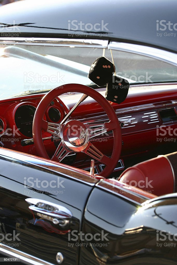 A retro car with red interior and a black exterior royalty-free stock photo