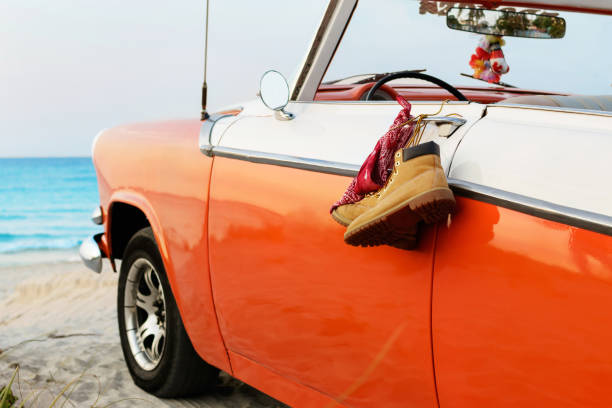 Retro car with tied boots and bandana to a door handle stock photo