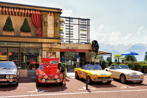 Retro cars parked near Casino building at Geneva Lake Montreux
