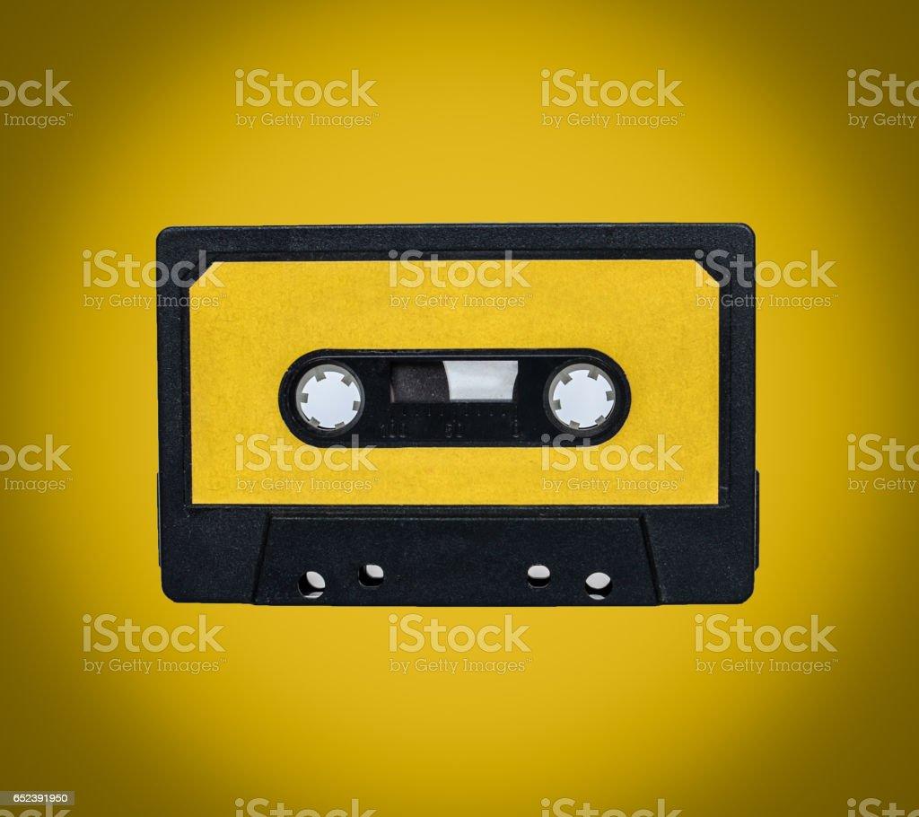 Retro cassete on yellow background stock photo