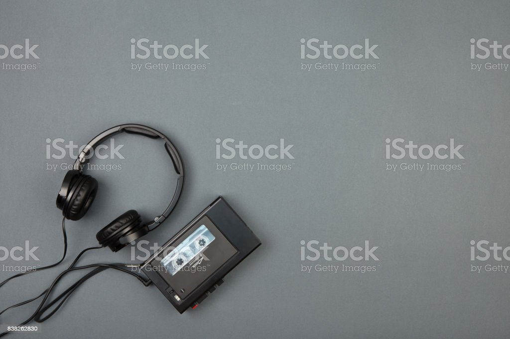Retro cassette player with headphones on grey background stock photo