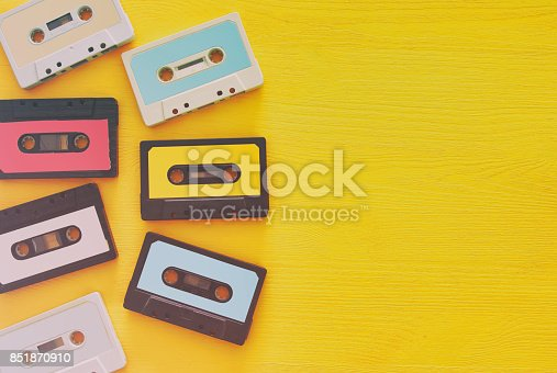 istock Retro cassette tape collection over yellow wooden table. top view. copy space 851870910