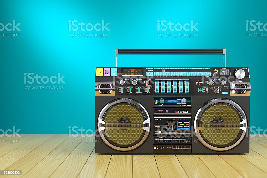 Retro cassette tape recorder on wooden table stock photo