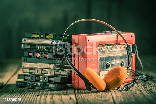 istock Retro cassette tape with headphones 1013208258
