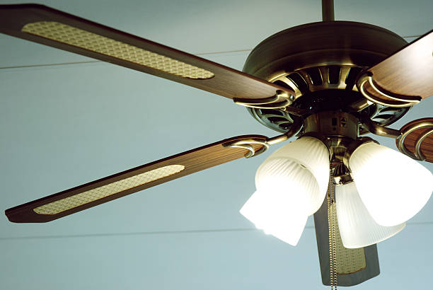 Retro Ceiling Fan a Cropped Household Ceiling Fan. ceiling fan stock pictures, royalty-free photos & images