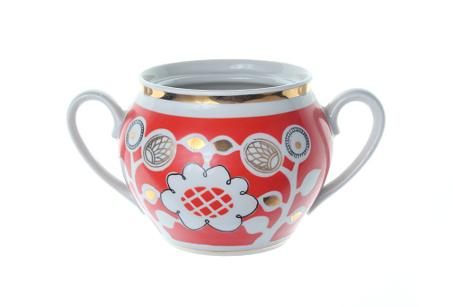 Retro ceramic sugar bowl with patterns isolated on white background