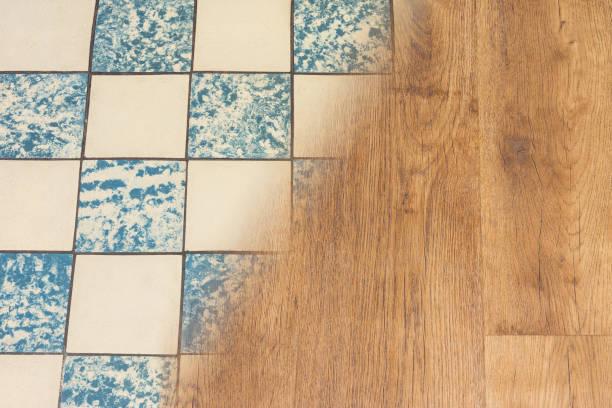 Retro ceramic tiles and modern vinyl floor. Housing renovation concept stock photo