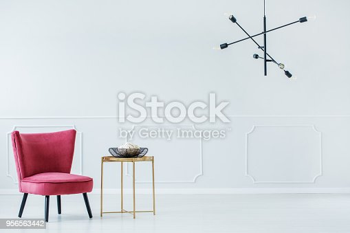 istock Retro chair and industrial chandelier 956563442