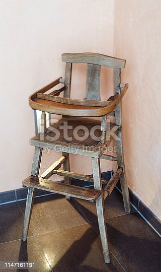 retro childrens wooden chair against the beige wall