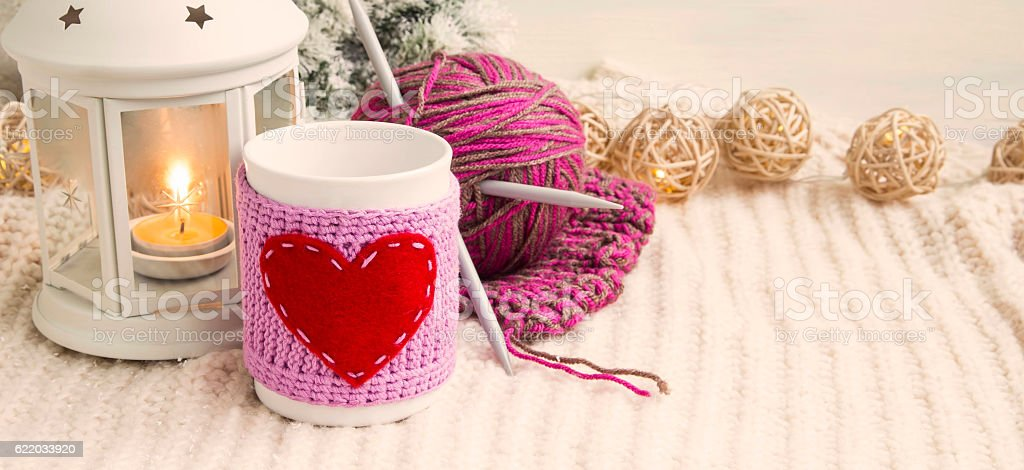 Retro Christmas decoration with cup, candle lantern and knitting stock photo