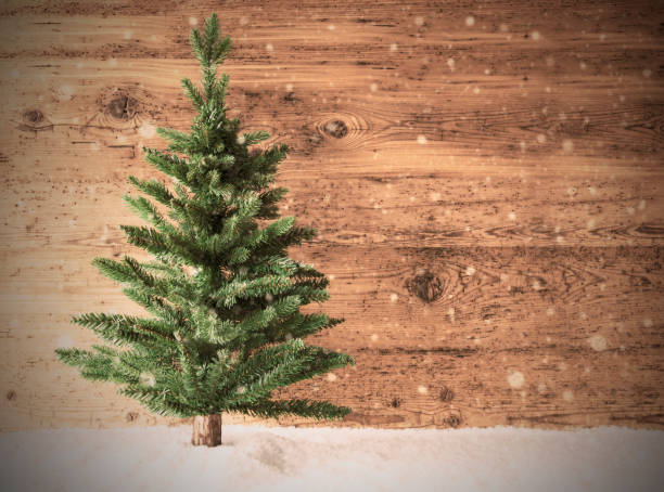 retro christmas tree, snow, copy space, wooden background - christmas tree stock photos and pictures