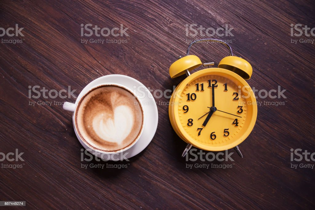 Retro Clock with cup of coffee morning stock photo