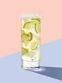 Cold refreshing cocktail on a pastel colored background