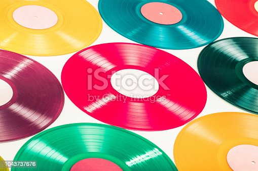 Retro color turntable vinyl discs for background. Vintage old style filtered photo