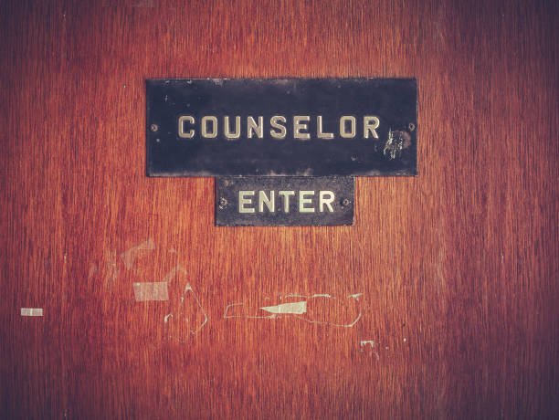 Retro Counselor Office Door Retro Grungy Counselor's Office Door At A Public School Or University school counselor stock pictures, royalty-free photos & images
