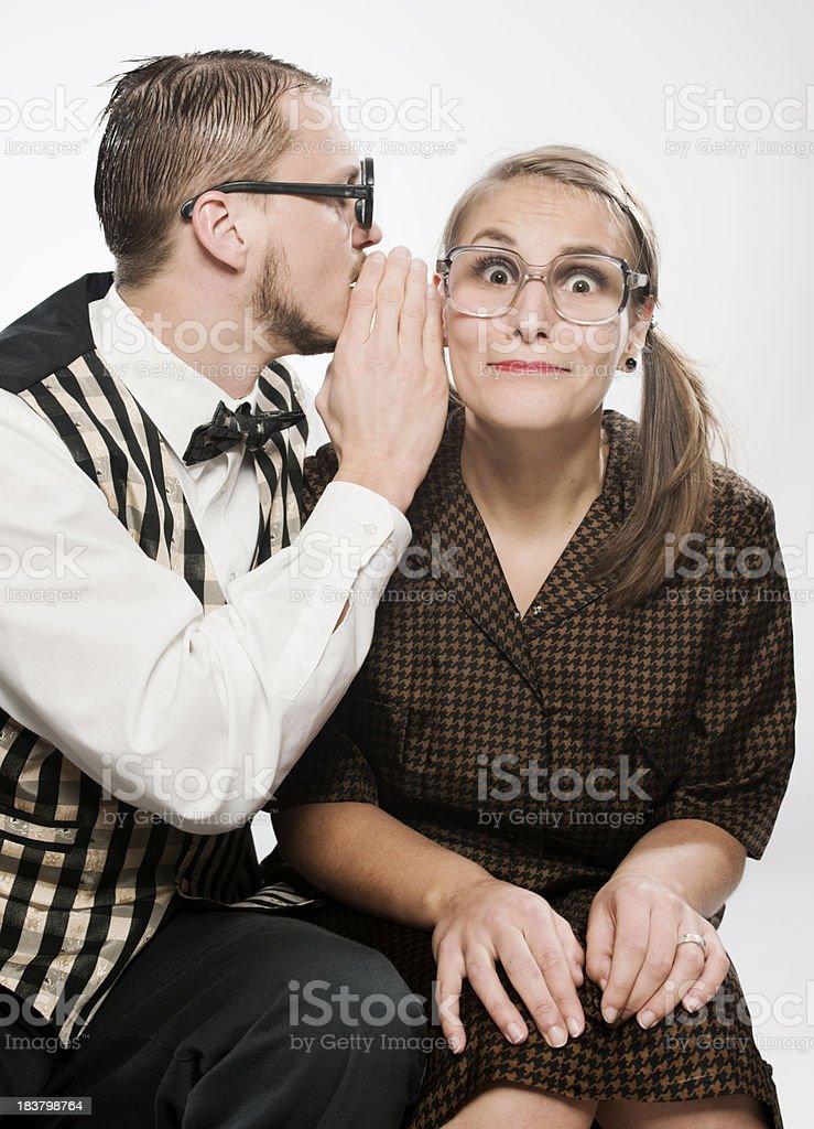 Retro couple having a secret royalty-free stock photo