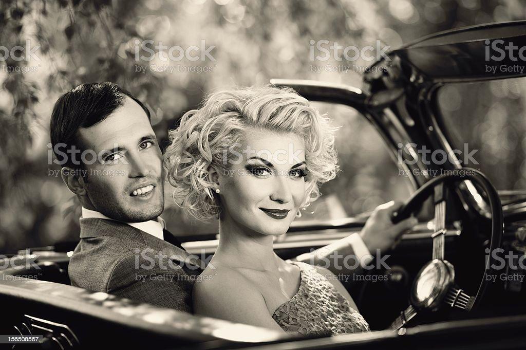 Retro couple in convertible stock photo