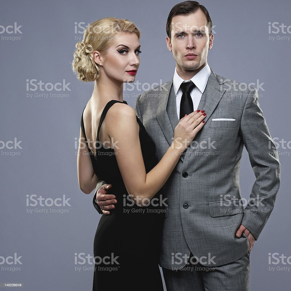 Retro couple on grey background. stock photo