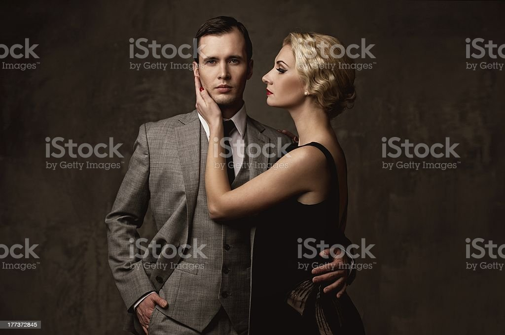 Retro couple on grey background stock photo