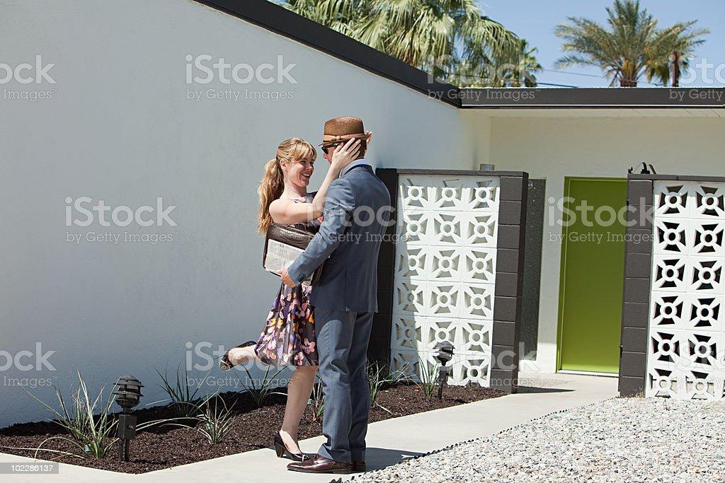 Retro couple outside home stock photo