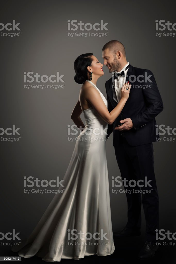 Retro Couple, Well Dressed Woman in Long White Dress, Elegant Man in Black Suit stock photo