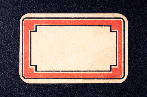 Retro design vintage styled blank rectangle label, red text border. Stylish old empty yellow paper sticker no text copy space Front of a book or a notebook labeling concept graphical resources cut out