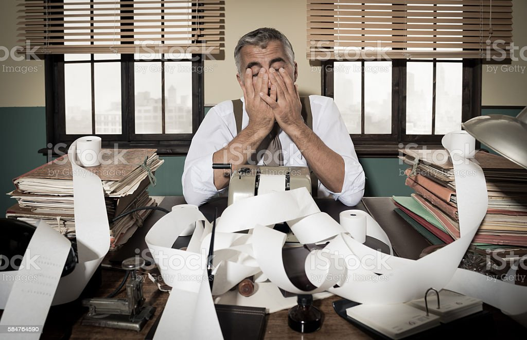Retro desperate accountant head in hands stock photo