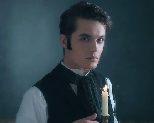 retro dickens style man with candlestick behind rainy window. - charles dickens weihnachtsgeschichte stock-fotos und bilder
