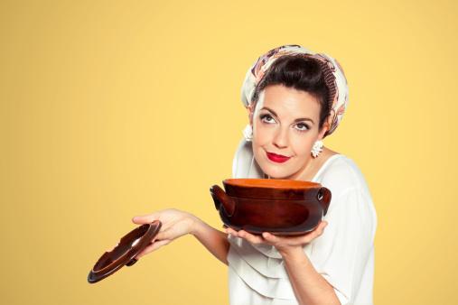 Retro Domestic woman preparing soup