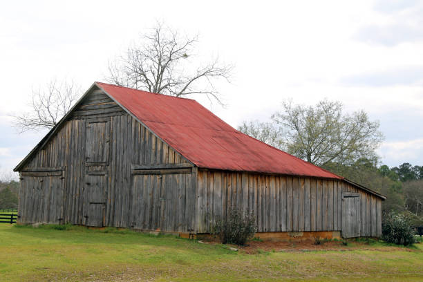 retro farm barn red roof empty field stock photo