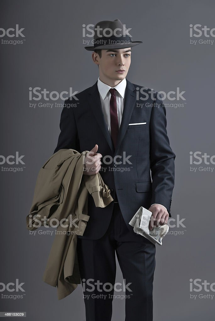 Retro fashion fifties young man with hat wearing dark suit. stock photo