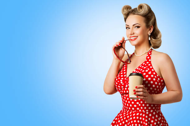 retro fashion model red polka dots dress, woman pinup beauty style, happy girl holding paper cup - pin up girl stock pictures, royalty-free photos & images