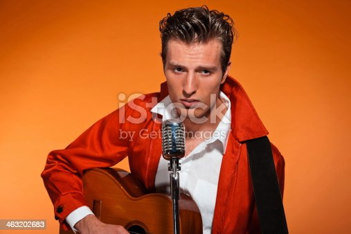 463242403 istock photo Retro fifties rock and roll singer playing accoustic guitar. 463202683