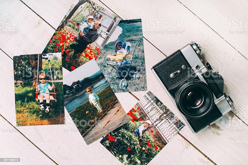 Retro film camera with retro photos royalty-free stock photo