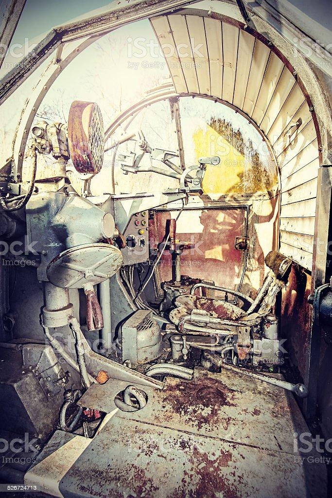 Retro filtered picture of machine gun cockpit. stock photo