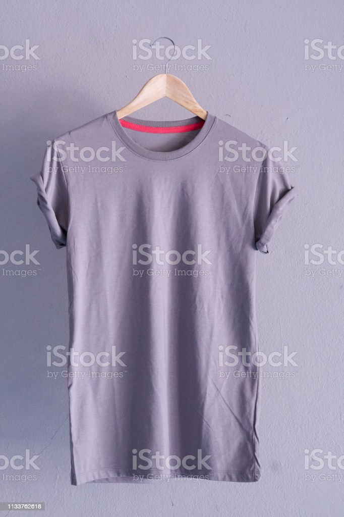 retro fold grey cotton tshirt clothes mock up template on gray cement background concept for