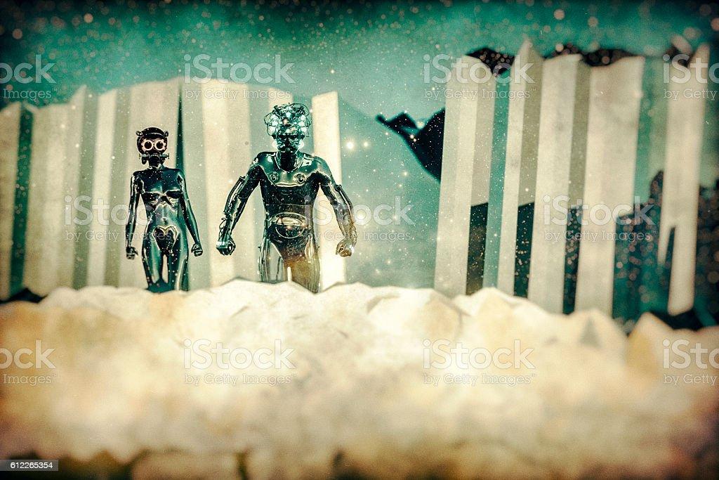 Retro futuristic alien couple on a distant planet stock photo