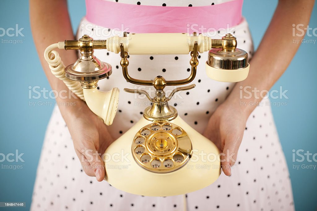 Retro Gal Holding a Vintage Victorian Style Candlestick Phone stock photo