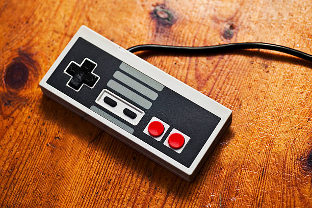Retro Game Console controller Retro Game Console controller gamepad stock pictures, royalty-free photos & images