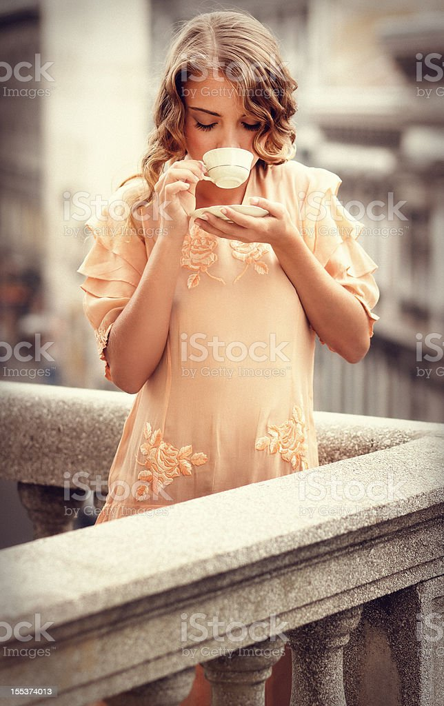 retro girl drinking coffee on the balcony royalty-free stock photo