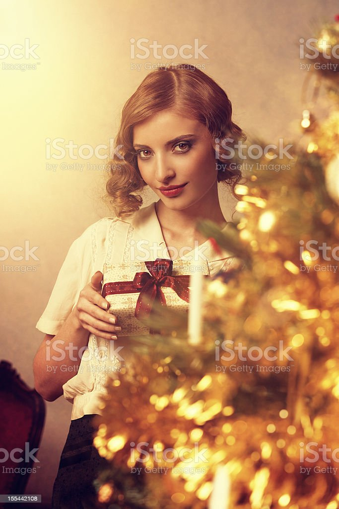 retro girl holding christmas gift royalty-free stock photo